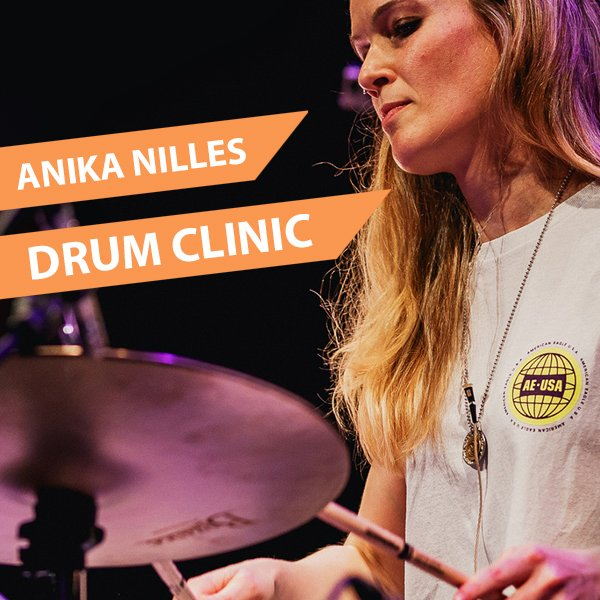 Anika Nilles playing drums
