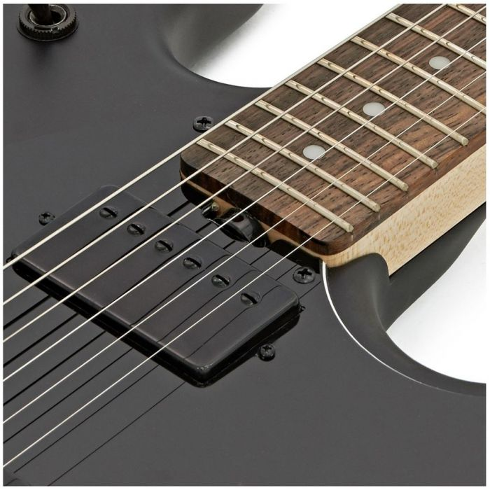 Closeup of the neck pickup on a Musicman Sterling SUB Stringray SR30 Guitar, Stealth Black