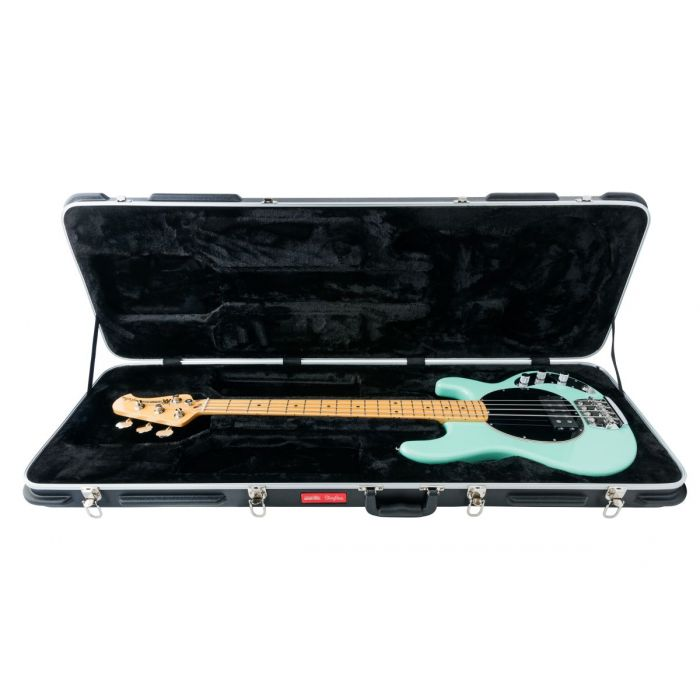 Mint Green Music Man StingRay Old Smoothie bass resting in its case