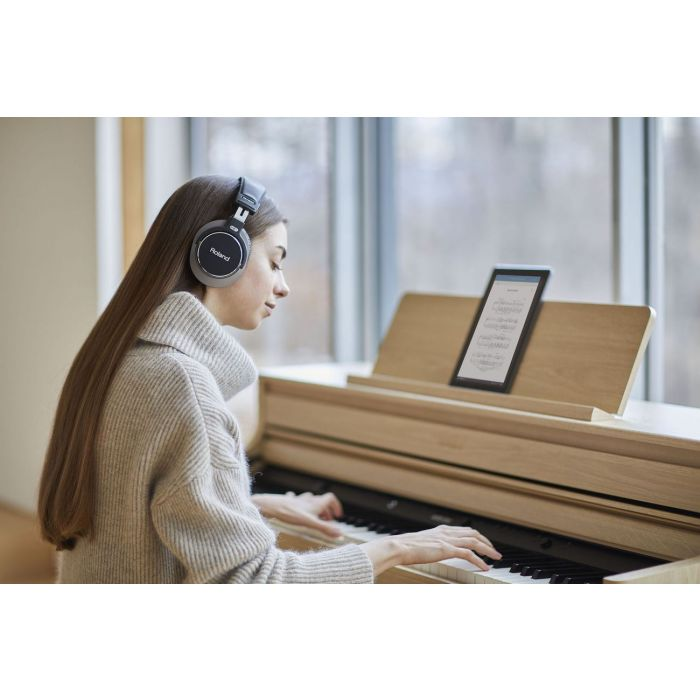 Woman playing Roland HP702 Piano