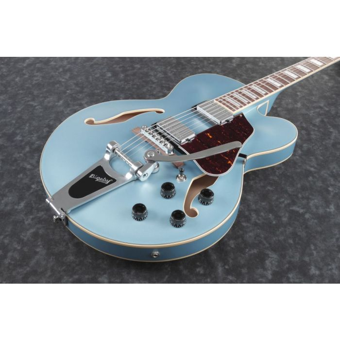 Front closeup image of a steel blue flat semi hollow electric guitar