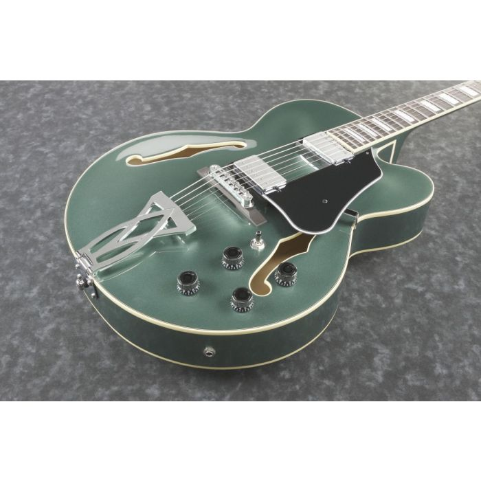 Front closeup of an Olive Metallic finished Ibanez Artcore AF75 hollow body guitar