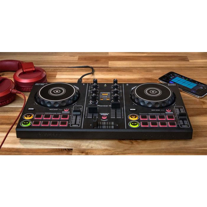 DDJ-200 On A Table with Headphones and a Phone