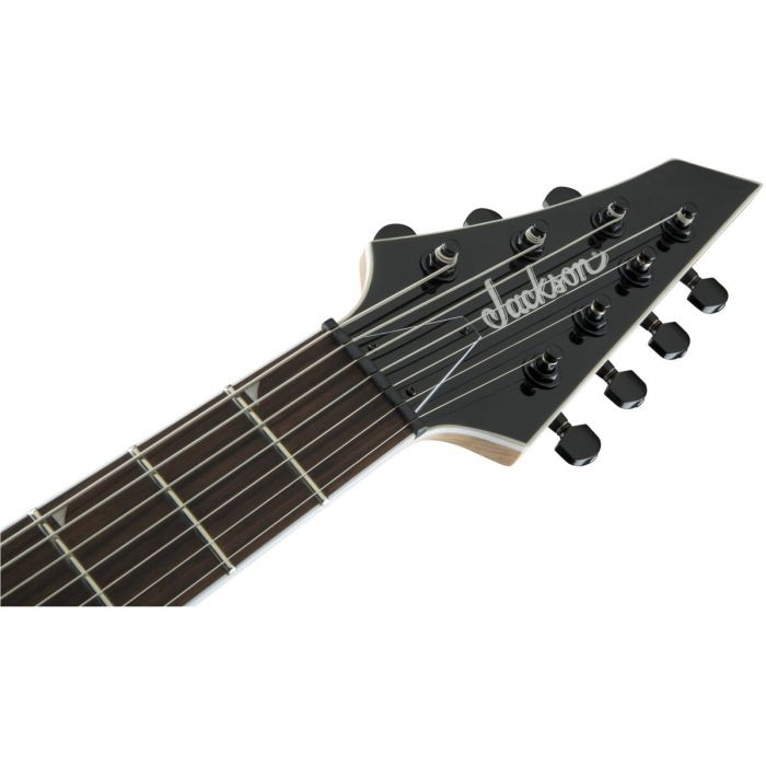 Front view of the headstock on a Jackson JS Series Dinky Arch Top JS32-7 DKA HT 7-String Snow White