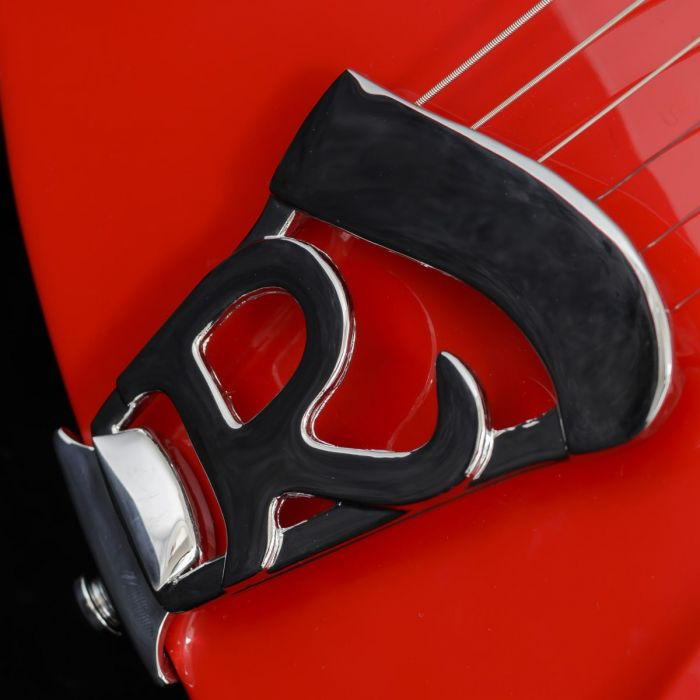 Closeup view of the tailpiece on a Rickenbacker Ltd Edition 360 Pillarbox Red Electric Guitar