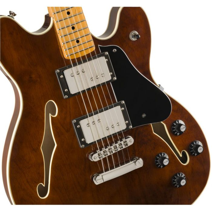 Closeup front view of a Squier Classic Vibe Starcaster MN Walnut
