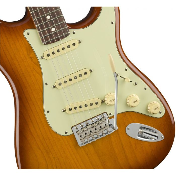 Closeup front view of a Fender American Performer Stratocaster RW Honey Burst