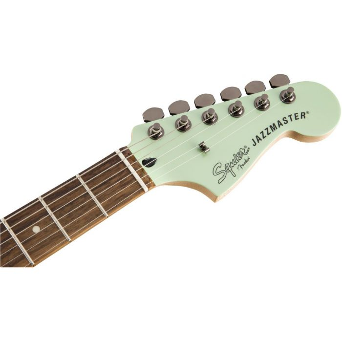 Front view of the headstock on a Squier Contemporary Active Jazzmaster HH ST Surf Pearl
