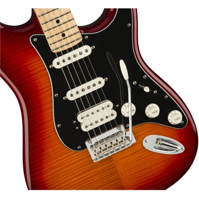 Front closeup view of a Fender Player Stratocaster HSS Plus Top MN Aged Cherry Burst