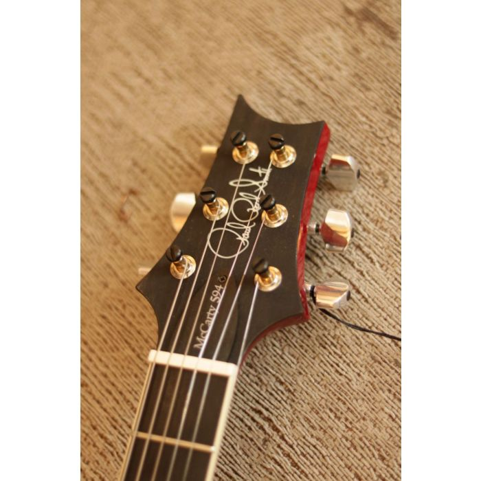 Closeup view of the headstock on a PRS Ltd Edition McCarty 594 Charcoal Cherryburst Ebony Electric Guitar