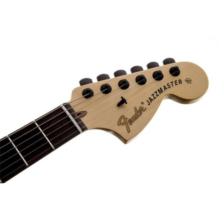 Closeup front view of the headstock on a Fender Jim Root Jazzmaster Electric Guitar Flat Black