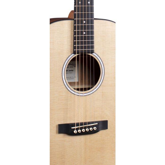 Closeup of the soundhole on a Martin 000Jr-10 Acoustic Guitar