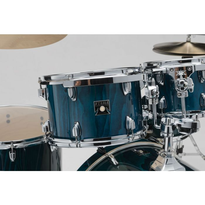 Closeup of the toms on a Tama Superstar Classic 7pc Shell Pack Gloss Sapphire Java LB Pine