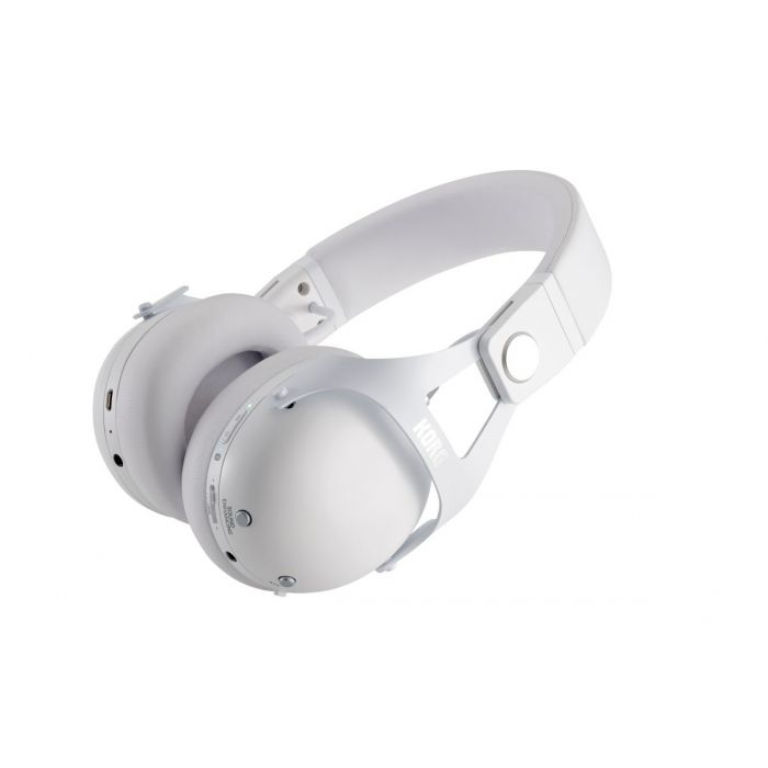 Angled view of a set of Korg NCQ1-WH Smart Noise Cancelling Headphones with a white finish