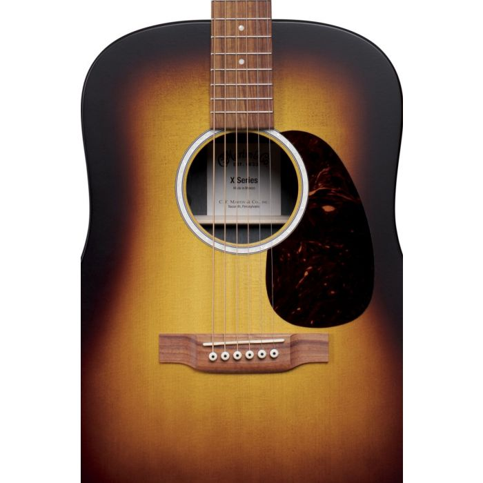 Closeup of the soundhole on a budget-friendly Martin D-X2E Burst electro acoustic guitar