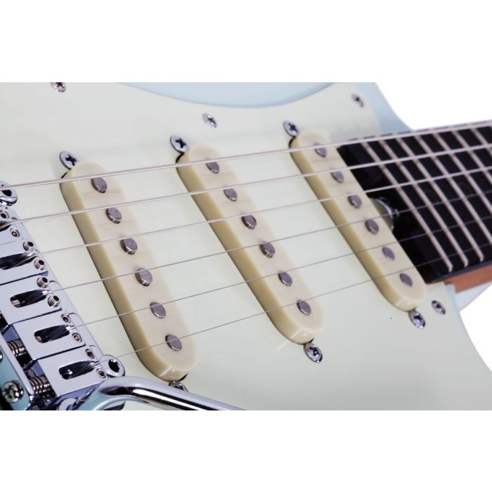 Closeup of the pickups on a Schecter Nick Johnston Traditional Atomic Frost Guitar