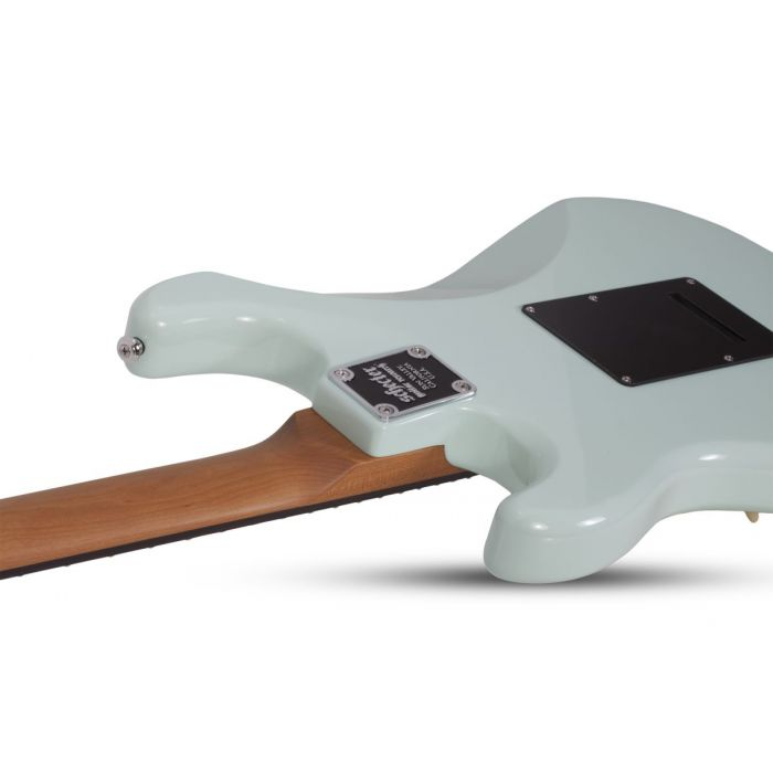 Rear-angled view of a Schecter Nick Johnston Traditional Atomic Frost Guitar