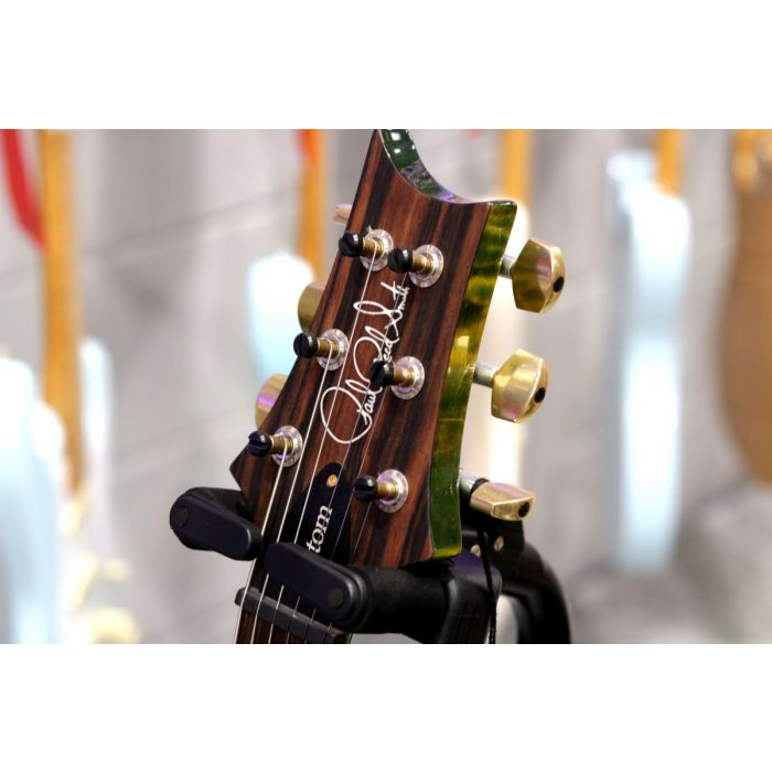 Closeup of the headstock on a PRS Custom 24 Emerald Flame Maple Electric Guitar, Ebony FB
