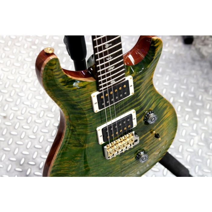 Front angled closeup of a PRS Custom 24 Emerald Flame Maple Electric Guitar, Ebony FB
