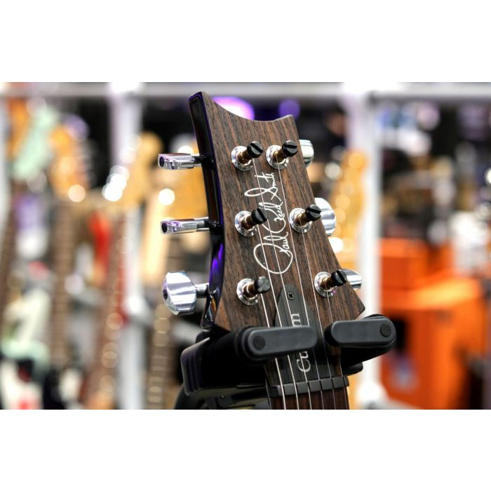 Front view of the headstock on a PRS Custom 2408 Violet Flame Maple Guitar