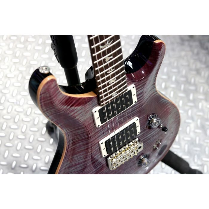 Closeup front angled vie wof a PRS Custom 2408 Violet Flame Maple Guitar
