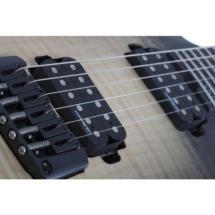 Closeup of the pickups on an Ember Burst Schecter Banshee Mach-6 Guitar