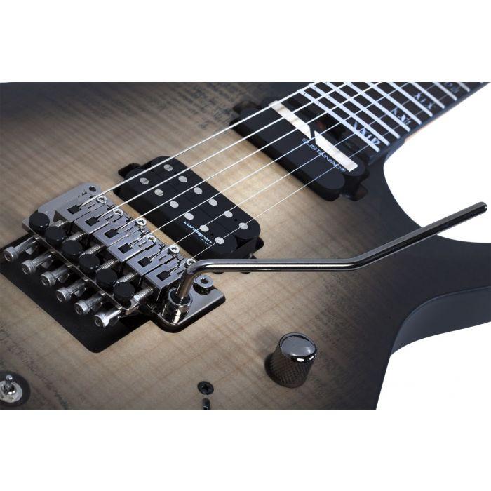 Closeup of the pickups on a Schecter Banshee Mach-6 FR-S Guitar, Ember Burst