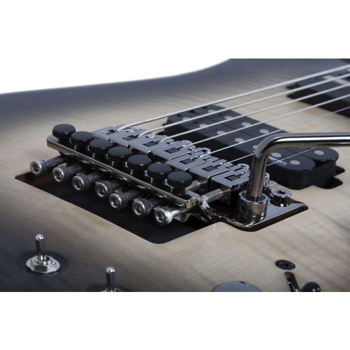 Closeup of the Tremolo bridge on a Schecter Banshee Mach-7 FR-S Guitar, Ember Burst