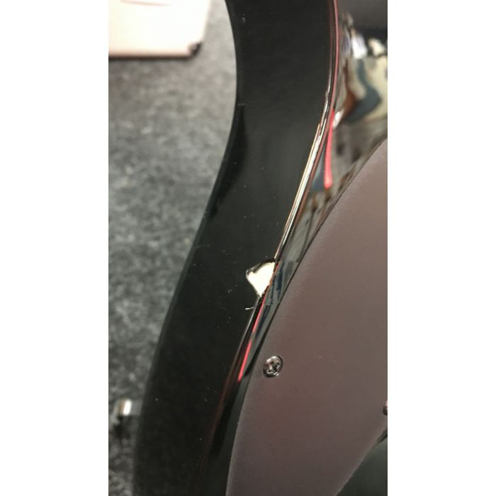 Closeup of the damage on the lower curve on a B-Stock Ibanez Ltd Edition RG Iron Label in Foggy Stained Black