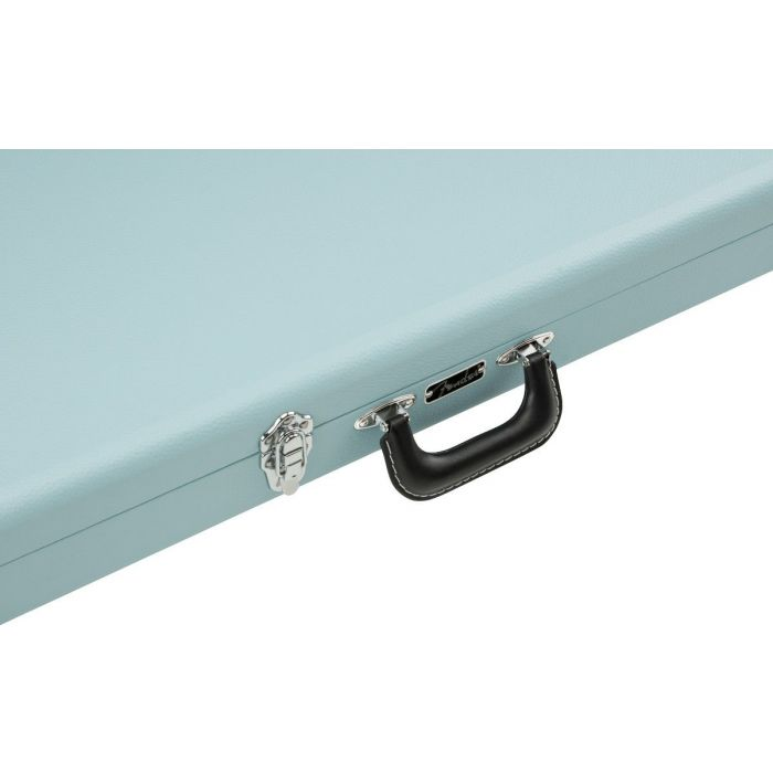 Closeup of the handle on a Fender Classic Series Wood Case for Strat or Tele, Sonic Blue