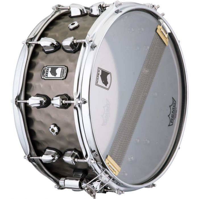 Underside view of a Mapex Black Panther Persuader Hammered Brass Snare