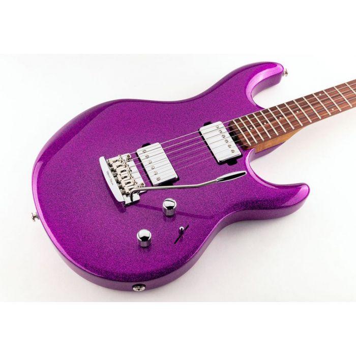 Closeup of the body on a Music Man Luke 3 HH Electric Guitar, Fuschia Sparkle