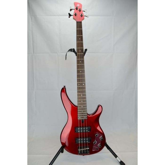Full frontal view of a B Stock Yamaha TRBX304 Bass Guitar Candy Apple Red