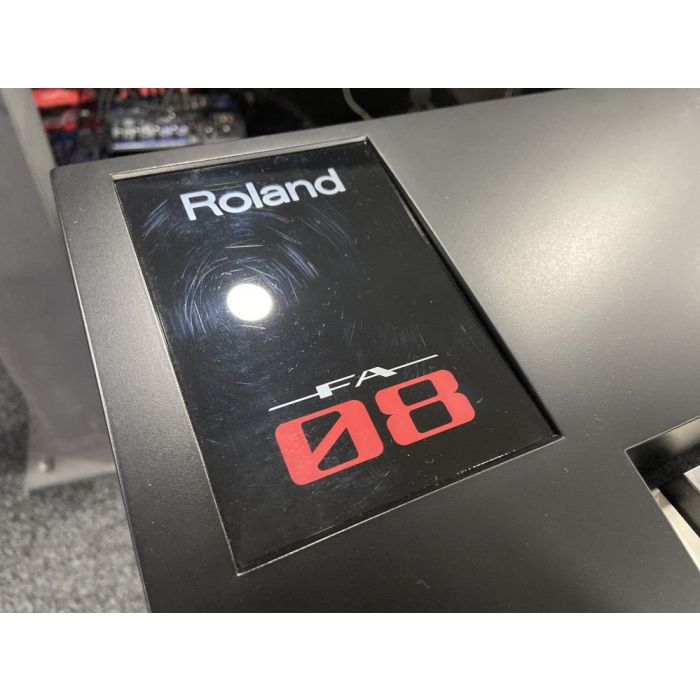 Closeup of the logo on a B Stock Roland Fantom FA-08 Music Synthesizer Workstation