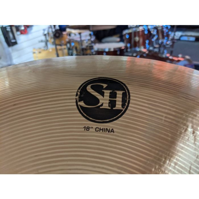 Closeup of the logo on a Pre-Loved Stagg SH 18 China Cymbal