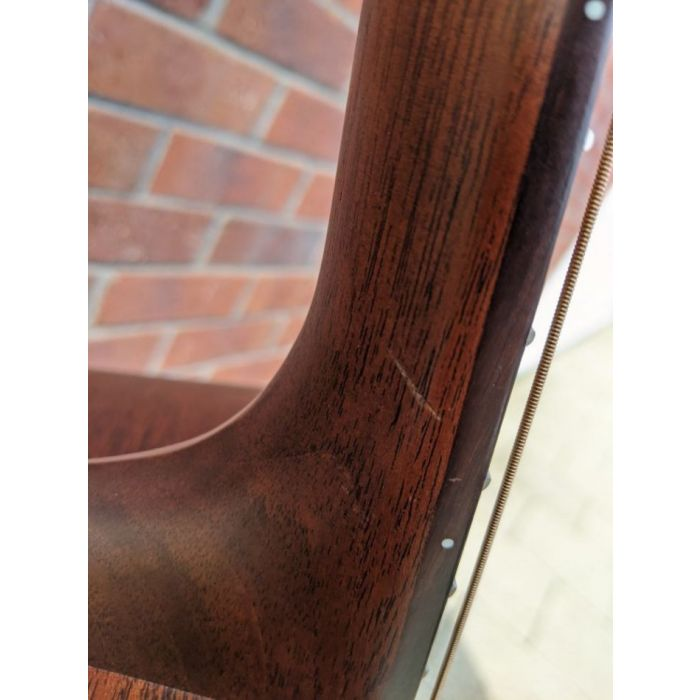 Closeup of the damage on a B-Stock Martin D-15M Acoustic
