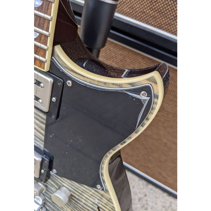 Detailed view of the damage on a B-Stock Yamaha Revstar RS720B Electric Guitar, Ash Grey