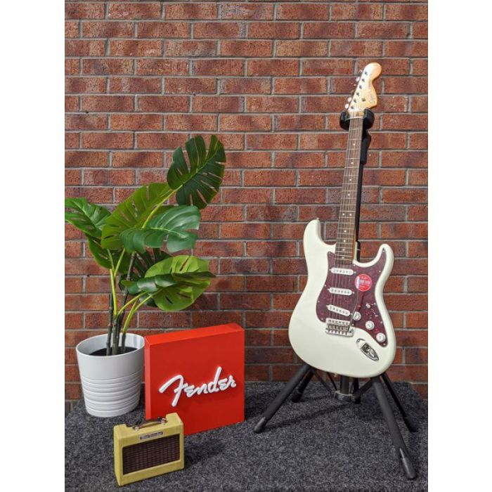 Lifestyle view of a B Stock Squier Classic Vibe 70s Stratocaster, Olympic White