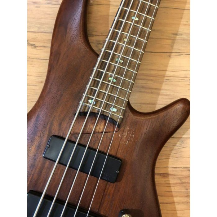 Closeup of the body on a Pre Loved Ibanez SR505 5 String Bass in Brown Mahogany