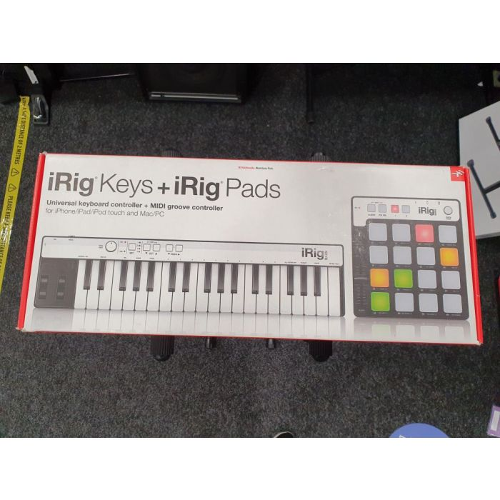 Full view of a packaged Pre-Loved iRig Keyboard and Pads MIDI Controller box