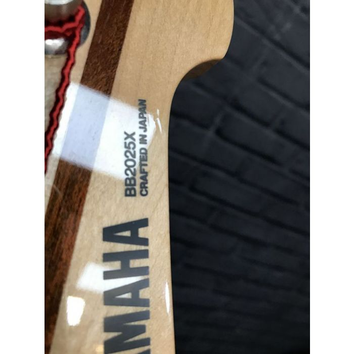 Closeup of the headstock on a Pre-Loved Yamaha BB2025X 5-String Bass, Vintage White
