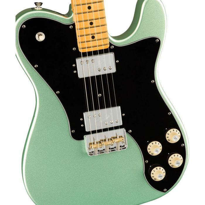Closeup of the body on a Fender American Professional II Telecaster Deluxe, Mystic Surf Green