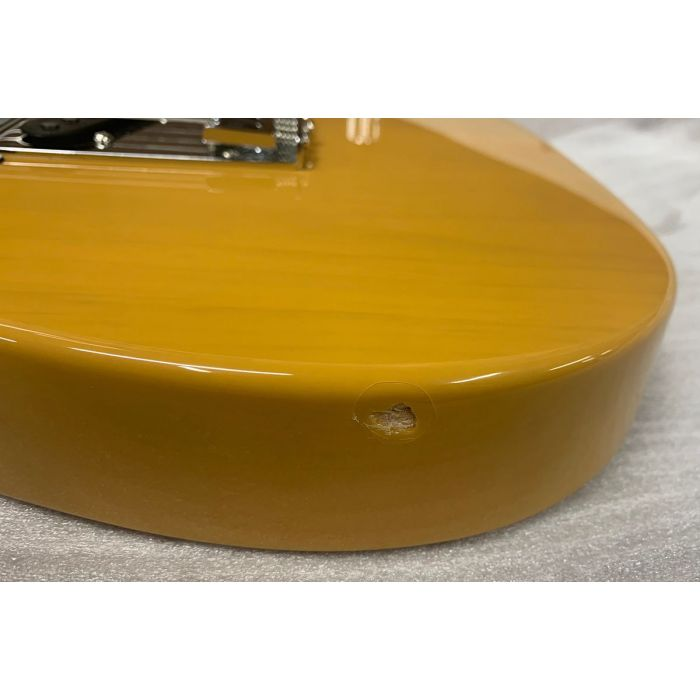 Closeup of the damage on a B Stock Fender Player Telecaster MN in Butterscotch Blonde