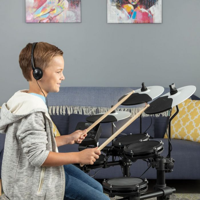 Boy Learning To Play Drums with The Alesis Debut Electronic Drum Kit