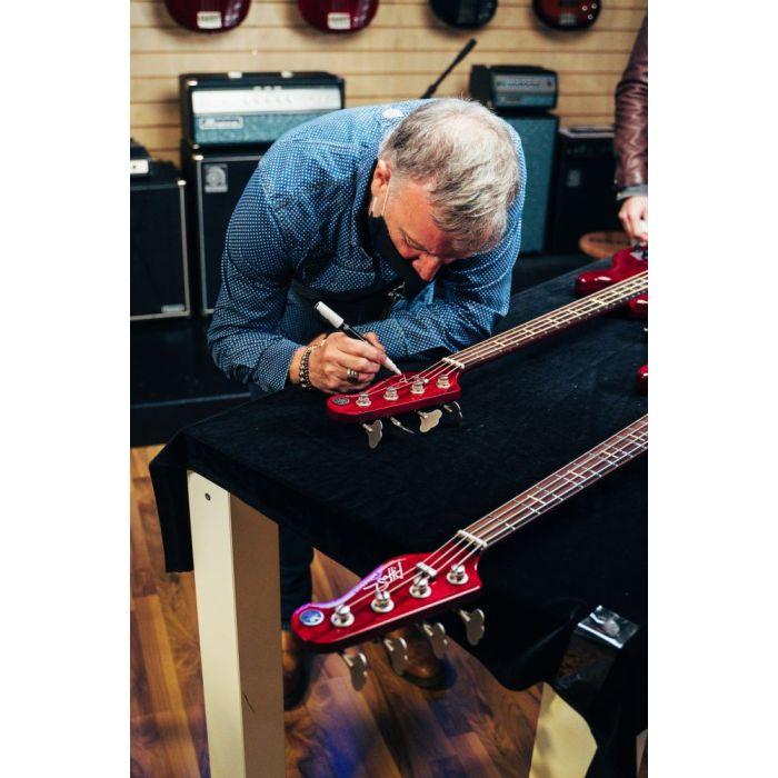 Peter Hook signing his signature Yamaha BB Bass