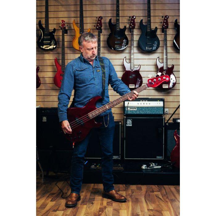 Peter Hook proudly displaying his new signature Yamaha BB Bass guitar