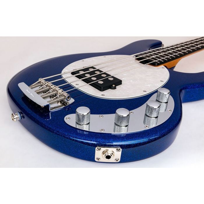 Closeup of the body on a Music Man Stingray Special Bass, Tectonic Blue Sparkle