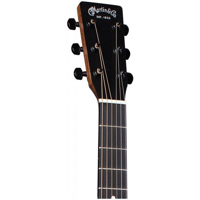 Closeup of the headstock on a Martin 000-12E Koa Electro Acoustic Guitar