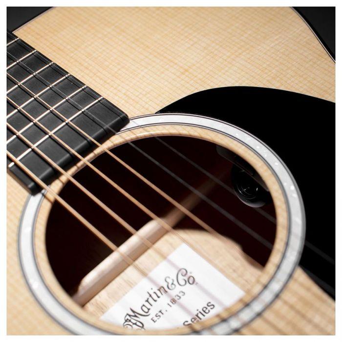 Closeup of the soundhole on a Martin 000-12E Koa Electro Acoustic Guitar