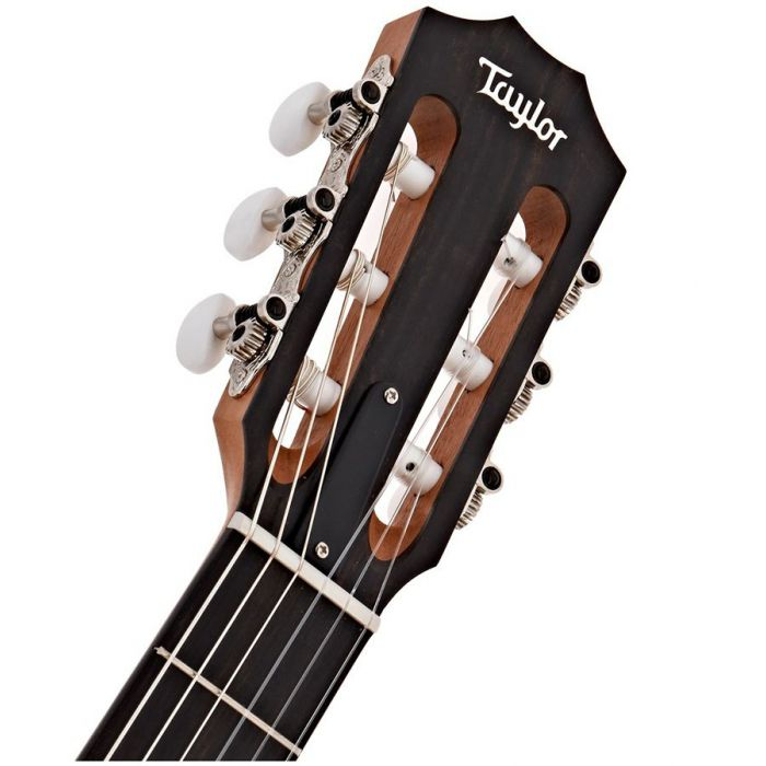 Closeup of the headstock on a Taylor 214ce-N Nylon String Guitar, Natural